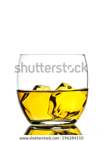 One glass of whiskey on white background