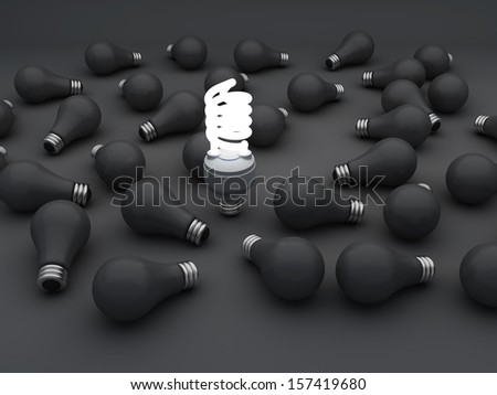 one glowing compact fluorescent light bulb standing out  from the unlit incandescent light bulbs or Individuality concept - stock photo