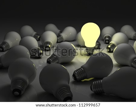 One glowing light bulb standing out from the unlit incandescent bulbs with reflection , The business concept and individuality concept