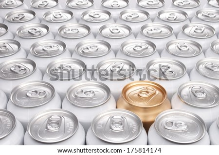 One Gold Can Among a Group of Aluminum Beverage Cans - stock photo