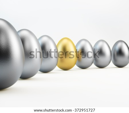 One golden colored egg is  standing out from silver colored eggs. Isolated on white background. Clipping path is included. Great use for business related concepts and metaphors.