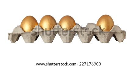 One golden egg missing from a tray of golden eggs isolated on white background  - stock photo