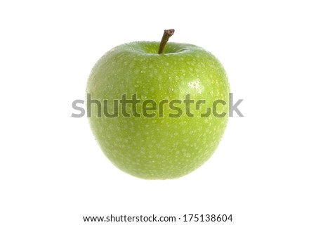 One green apple covered by water drops on white background isolated