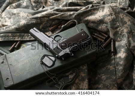 one gun colt on khaki clothing military uniforms with sleeves for the arms box