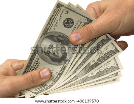 One hand gives money in other hand over white  background - stock photo