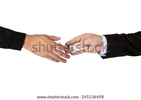 One hand handing over money banknotes to another hand isolated on a white background.