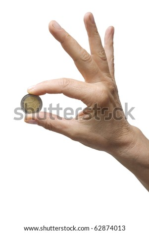 one hand holding a coin - stock photo