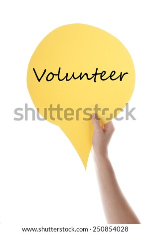 One Hand Holding A Yellow Speech Balloon Or Speech Bubble With English Text Volunteer Isolated On White - stock photo