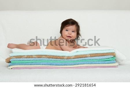 one happy baby on towel - stock photo