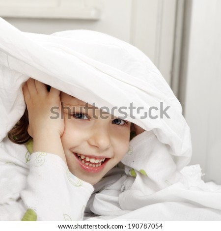 One happy child in the bed - stock photo