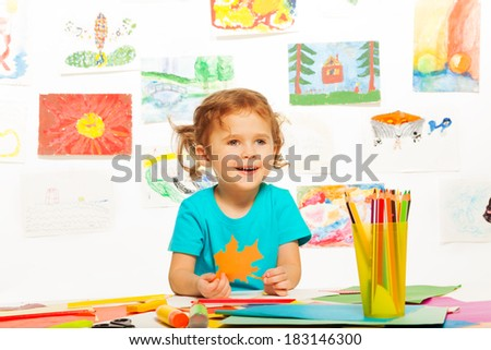 One happy cute little girl painting on creative class in kindergarten - stock photo