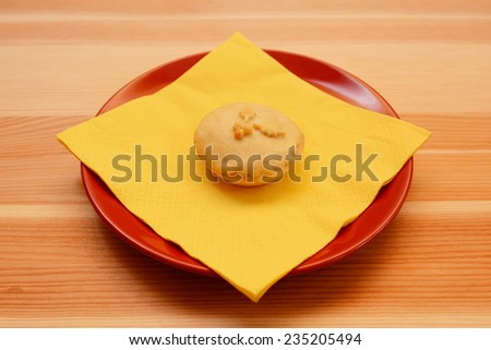 One homemade Christmas mince pie with a yellow napkin on a wooden table - stock photo