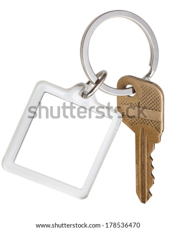 one house brass key and square keychain on ring isolated on white background