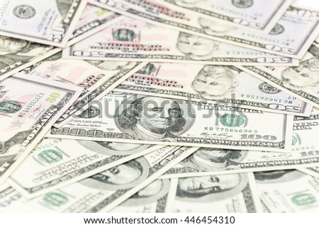 One hundred and fifty dollars banknotes on the table - stock photo