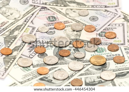 One hundred and fifty dollars banknotes with cents coins as background - stock photo