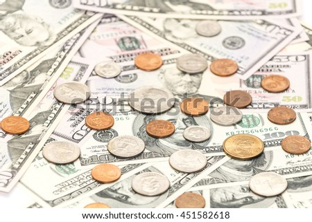 One hundred and fiftys dollars banknotes with cents coins as background - stock photo