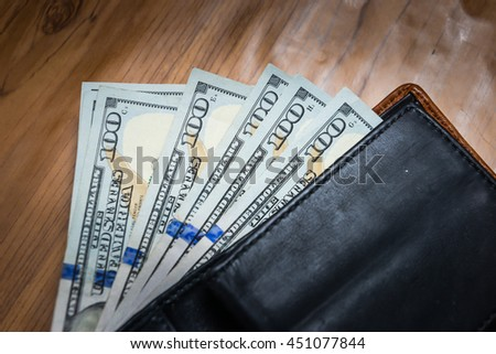 One hundred bills in wallet with vignett - stock photo