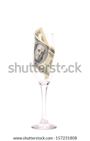 One hundred dollar banknote in the glass. Isolated on a white background.