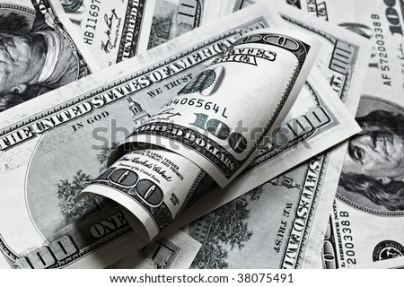 One hundred dollar banknotes background with roll - stock photo