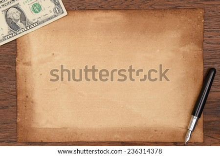 one hundred dollar bill and pen with old papers. - stock photo