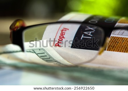 One hundred dollar bill on financial paper - stock photo
