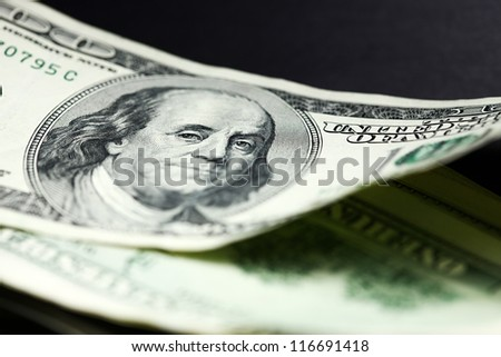 One hundred dollar bill. Selective focus.