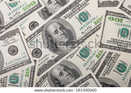 One hundred dollar bills pile background