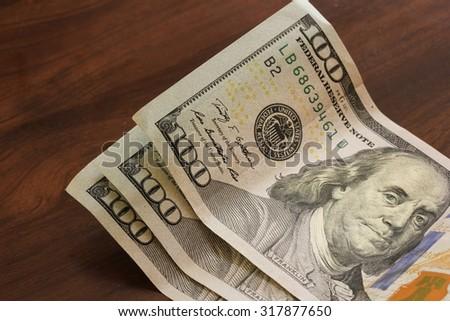 One Hundred Dollar Bills, selective focus - stock photo