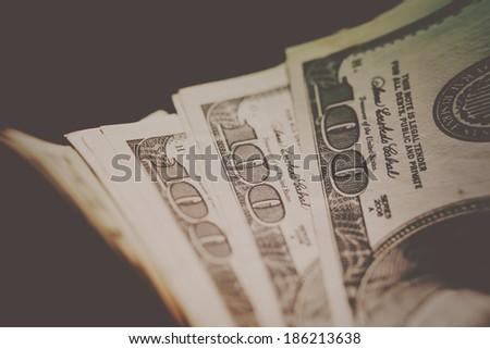 One hundred dollar bills. Small depth of field. - stock photo