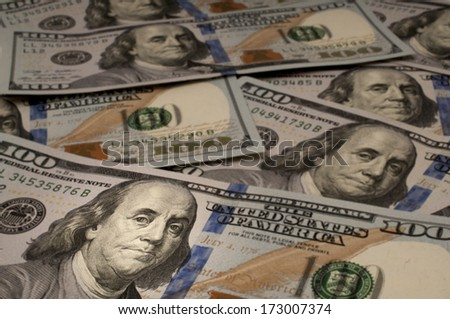 One Hundred Dollar bills with Benjamin Franklin highlighted - stock photo