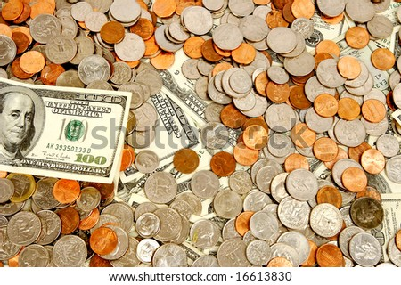One hundred dollar mixed with change - stock photo