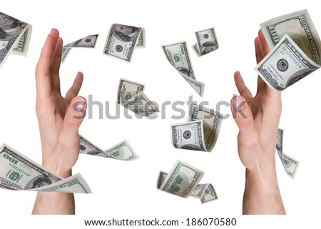 One hundred dollar money banknotes flying and falling on young male hands, isolated on white background.