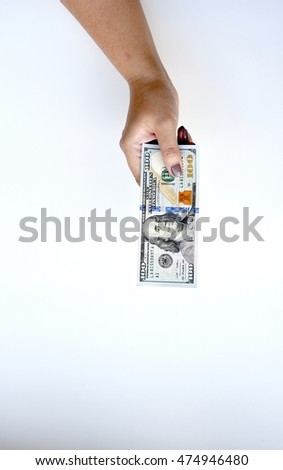 One hundred dollar on hand isolated on white background