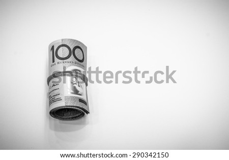 One hundred dollars Australian notes roll on black and white color - stock photo