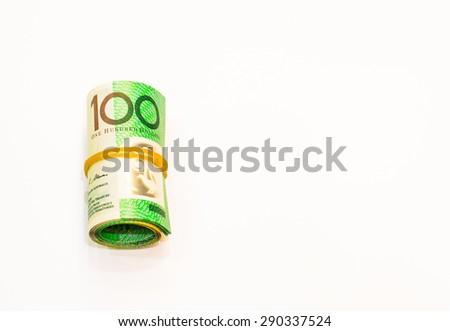 One hundred dollars Australian notes roll on white background - stock photo
