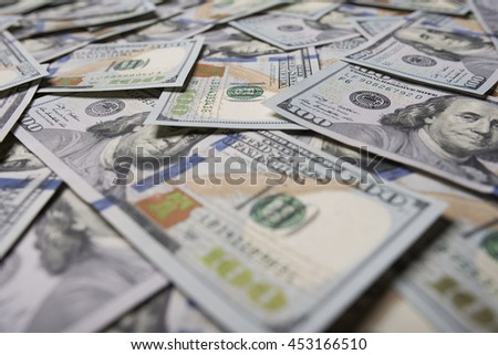 One hundred dollars background. Background paved with hundred dollar bills. - stock photo