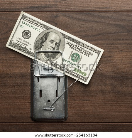 one hundred dollars banknote as a bait in mousetrap concept - stock photo