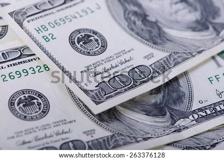 One hundred dollars banknotes as a background close-up - stock photo