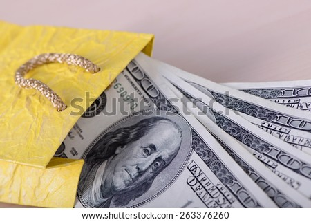One hundred dollars banknotes in package closeup - stock photo