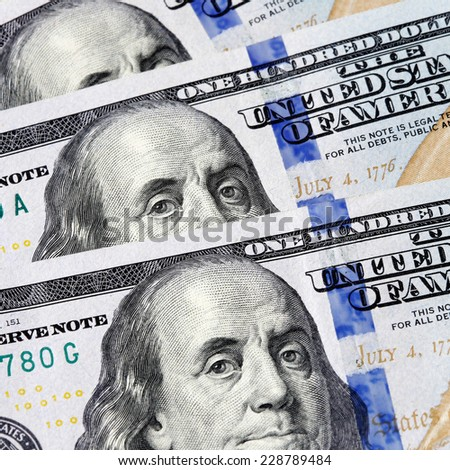 One hundred dollars close-up. Detail of hundred-dollar bills. - stock photo