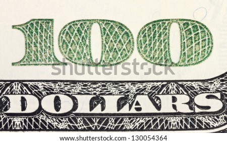 One hundred dollars corner of banknote with magnification - stock photo