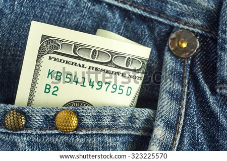 One hundred dollars in his pocket. - stock photo