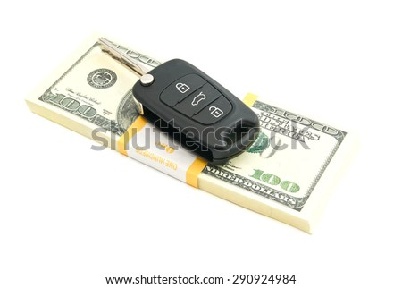 one hundred dollars notes and car keys on white - stock photo