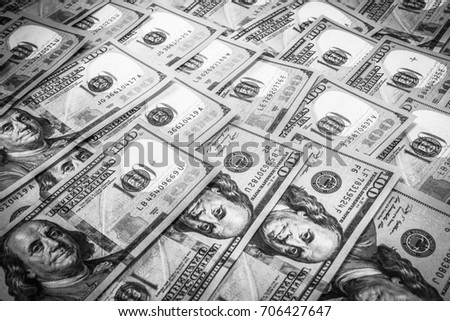 One hundred dollars notes in black and white
