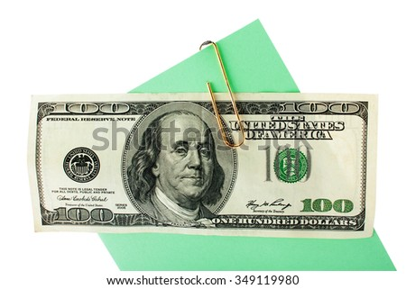 one hundred dollars on postcard attached by a paper clip on a white background isolated