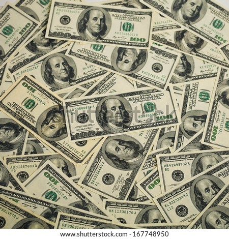 One hundred dollars pile as background. - stock photo
