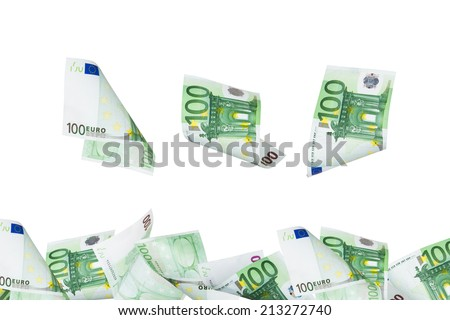 One hundred euro banknotes flying and raining with copy space, isolated on white background. - stock photo