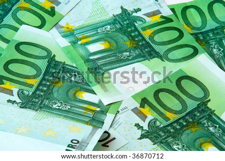One hundred euro nominal banknotes lying mixed background