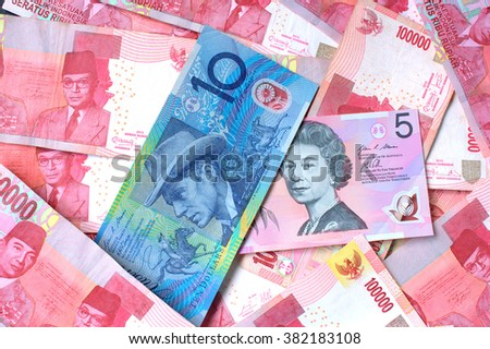 One Hundred thousand rupiah and Australian dollar note - stock photo