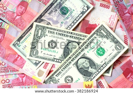 One Hundred thousand rupiah and US dollar note - stock photo